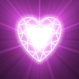 Power of love heart glowing flare. Brighten heart with jewel like diamond cutting frame filled with strong light and powerful halo. Valentine design and wedding Stock Images