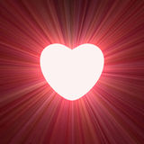 Power of love heart glowing light flare Royalty Free Stock Image