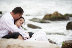 Power of love (newlyweds couple in the sea) Royalty Free Stock Images