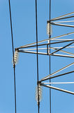 Power Mast Fixtures. Seen from below, with three parallel power lines Royalty Free Stock Images