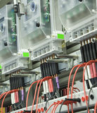 Power meters. Line up of electric power meters on  electrical panels Royalty Free Stock Photography