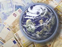 Power of money. This image shows that the Earth is sitting on the money Royalty Free Stock Photos