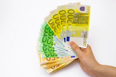 Power of money. Euros different denominations in hand,photography Royalty Free Stock Images