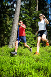 Power nordic walking. A couple nordic walking in the forest Stock Image