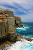 Power of the Ocean. Cliff Face at Albany, Australia Stock Photos