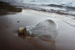 Power off lamp. On the beach stock photos