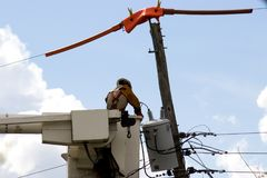 Power out due to Hurricane Irma. Power and light working on in Miami to bring electrical power back in North Miami Beach, FL, after Hurricane Irma Royalty Free Stock Photos