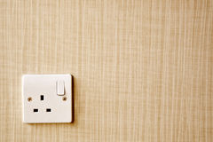 Power outlet at the corner of a wall Stock Images