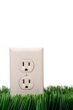 Power outlet on grass Royalty Free Stock Photo