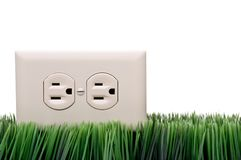 Power outlet on grass Stock Images