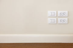 Power outlet and  light switch on the wall Stock Photography
