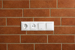 Power outlets on the brick wall Stock Photo