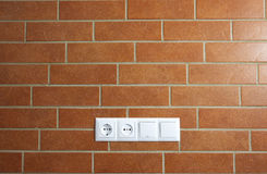 Power outlets on the brick wall / horizontal Stock Photos