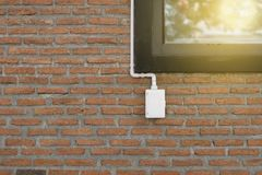 Power outlets on the brick wall vertical orientation. Electrical outlet on a red brick wall concept of power or connectivity,power outlets on the brick wall Stock Photography