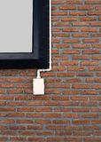 Power outlets on the brick wall vertical orientation. Electrical outlet on a red brick wall concept of power or connectivity,power outlets on the brick wall Stock Image