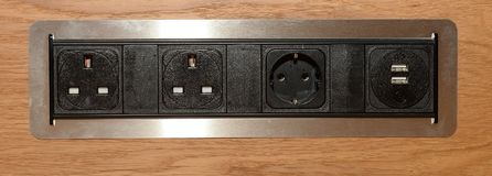 Power outlets. Close up of black power socket or outlets in wood Stock Images