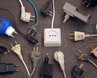 Power outlets and multiple plugs from electronic devices, top vi Royalty Free Stock Photos