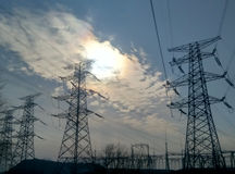 Power output equipment. The blue sky under the huge energy power output devices Stock Photos