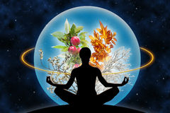 Power over nature. Female yoga figure against a space background and a planet (composed of four branches in different season of the year), as a concept for royalty free stock photography