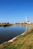 Power Plant. Chimney with a river. Picture taken at Tel-Aviv harbor, Israel Stock Photography
