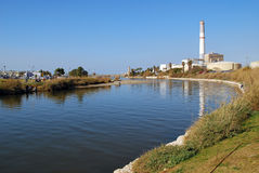 Power Plant. Chimney with a river. Picture taken at Tel-Aviv harbor, Israel Royalty Free Stock Photo