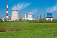 Power Plant. Thermoelectric plant. Power a major city that runs on natural gas. The picture shows the three towers of the cooling towers, chimneys and buildings Stock Photos