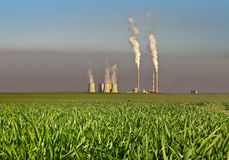 Power plant. With smoking chimney on green grass Royalty Free Stock Photography