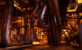 Power plant. Cabeles and pipes on power plant Royalty Free Stock Images