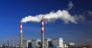 Power plant. The white smoke from power plant Royalty Free Stock Images