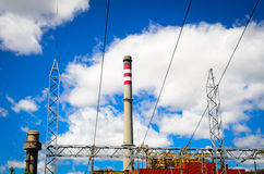 Power plant. Industrial chimney, power lines and sky Royalty Free Stock Photo