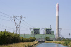 Power plant. With chimney and channel Royalty Free Stock Photo