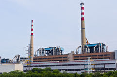 Power plant. Workshop and chimney of power plant Stock Photos