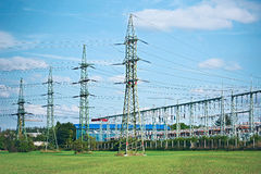 Power plant. Line of high voltage electric converters equipment at a power plant Royalty Free Stock Photos