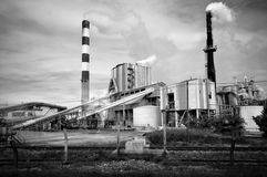 Power Plant. Air pollution by dark smoke coming out of two factory chimneys Stock Photos