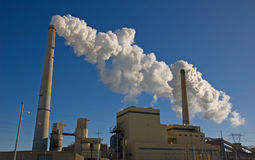 Power Plant. Photograph of a Power Plant in the midwest with billowing smoke coming from the chimneys stock photo