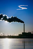 Power Plant. Silhouette with smoke and a cloud Royalty Free Stock Photography