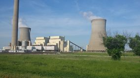 POWER PLANT ACROSS THE RIVER. Crossing into Indiana. The sheer size and architecture of this power plant is a site to behold. Standing alone in the middle of an royalty free stock photo