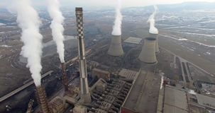 Power Plant. Aerial shot of power Plant and its cooling tower with steam rising from it stock footage