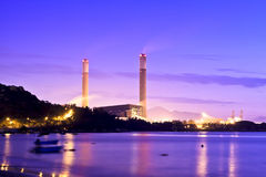 Power plant along coast at sunset Royalty Free Stock Photography