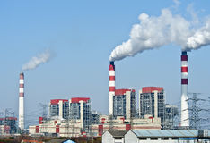Power plant with blue sky Royalty Free Stock Image
