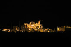 Power Plant. A brightly shining power plant at night Stock Photography