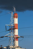 Power plant. Chimney and high voltage lines Royalty Free Stock Photos