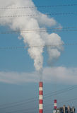 Power plant chimney and transmission lines Royalty Free Stock Image