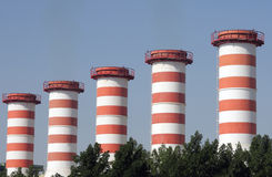 Power plant chimneys in Bahrain going green Stock Photo