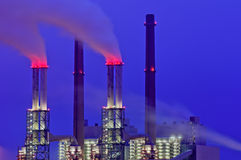 Power plant chimneys at night. Red smoke coming from industrial chimneys at night Royalty Free Stock Photography