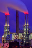 Power plant chimneys at night. Red smoke coming from industrial chimneys at night Royalty Free Stock Image