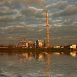 Power-plant with cloudy sky Stock Photography