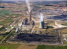 Power plant & coal piles, aerial Royalty Free Stock Photography