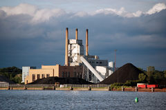 Power plant with coal piles Stock Photo