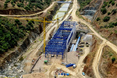 Power plant construction. Construction of the powerhouse of hydroelectric plant along the Guadiato river under the dam La Brana, Almodovar, Cordoba, Spain Royalty Free Stock Image